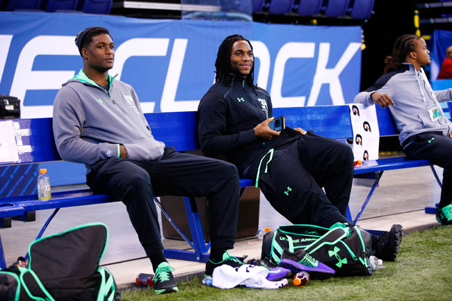 First-round talents Myles Jack (l.) and Jaylon Smith watch 2016 combine drills from the sideline while recovering from knee injuries.