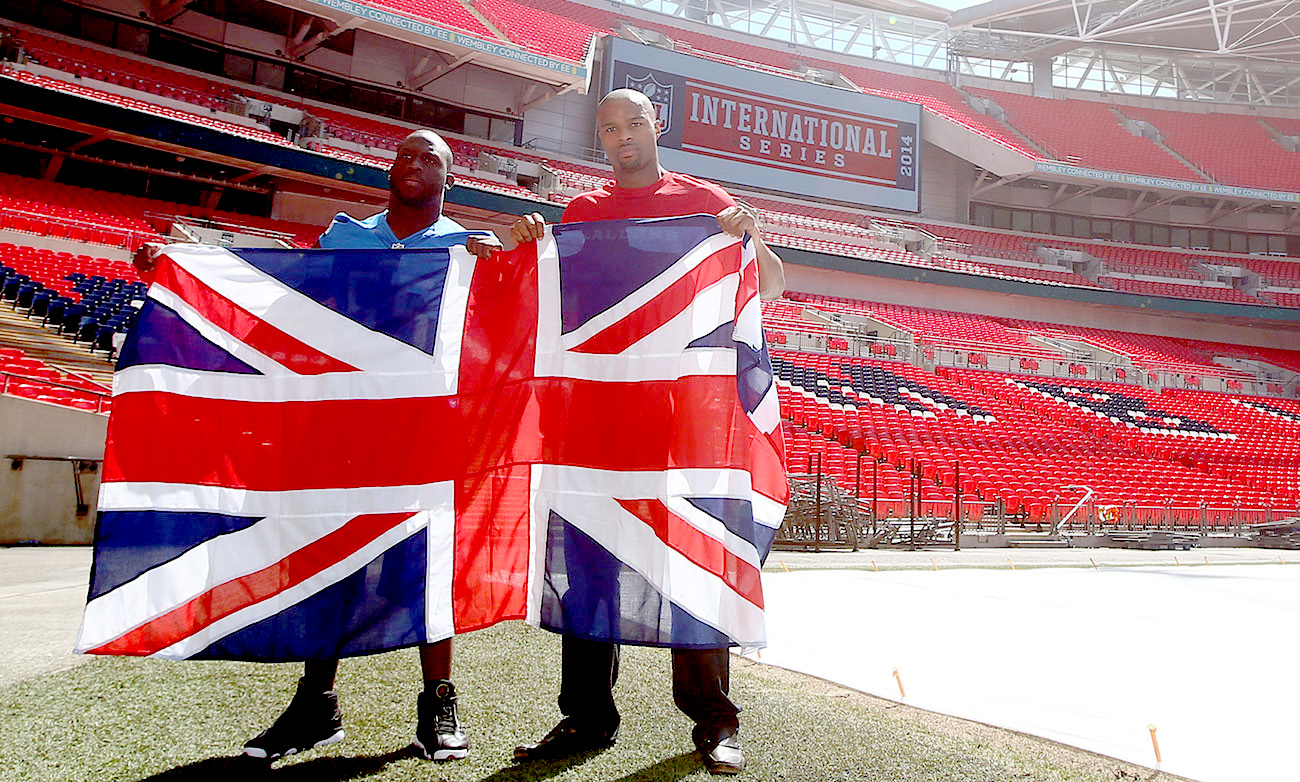 Umenyiora (in red, with Stephen Tulloch) played twice at Wembley, for the Giants and Falcons, and now works with NFL UK.