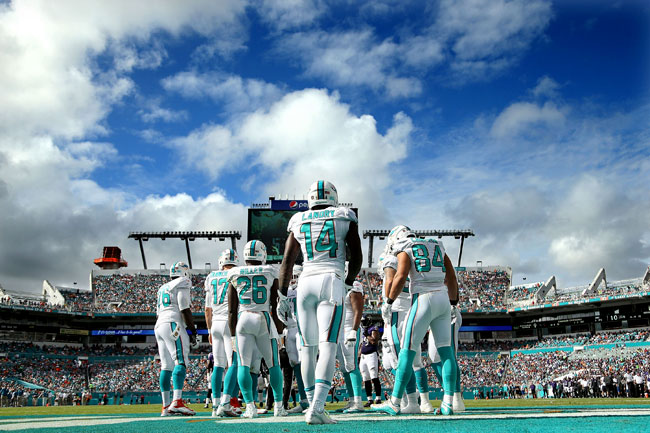 Miami Dolphins offensive huddle.