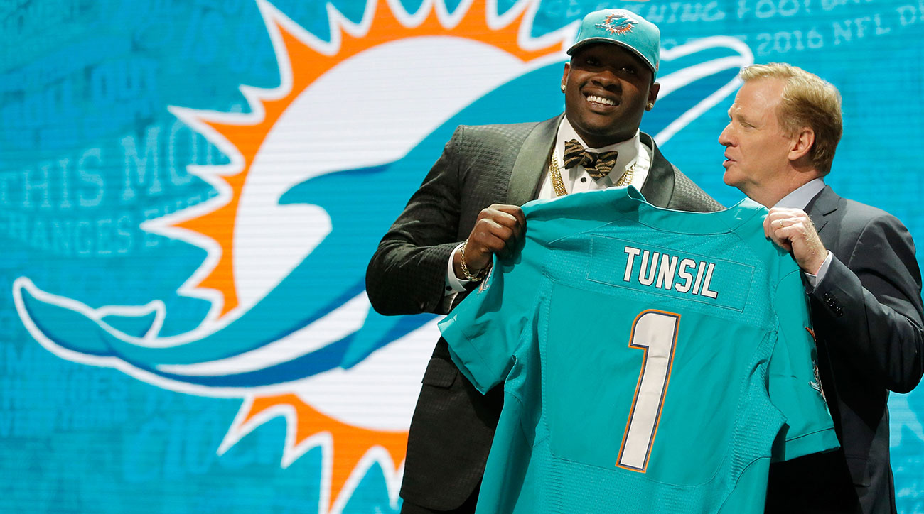 Laremy Tunsil holds up his Dolphins jersey after being selected No. 13 overall by the Miami Dolphins in the 2016 draft.