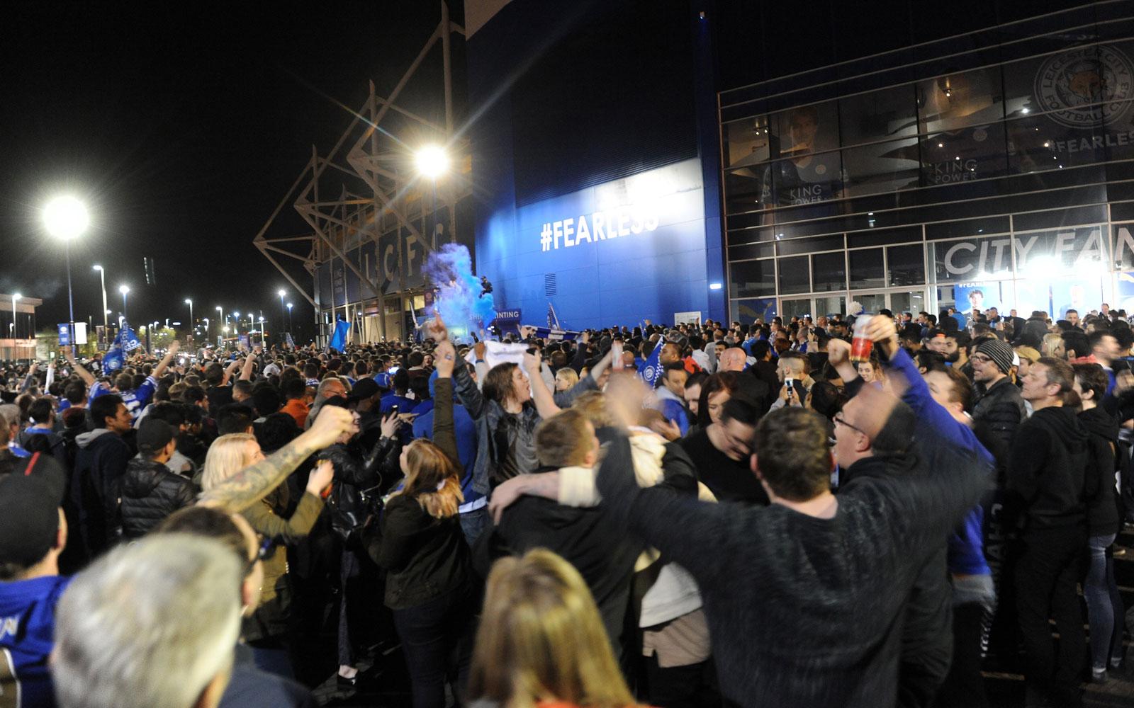 Leicester fans gather en masse around King Power Stadium to celebrate their Premier League title