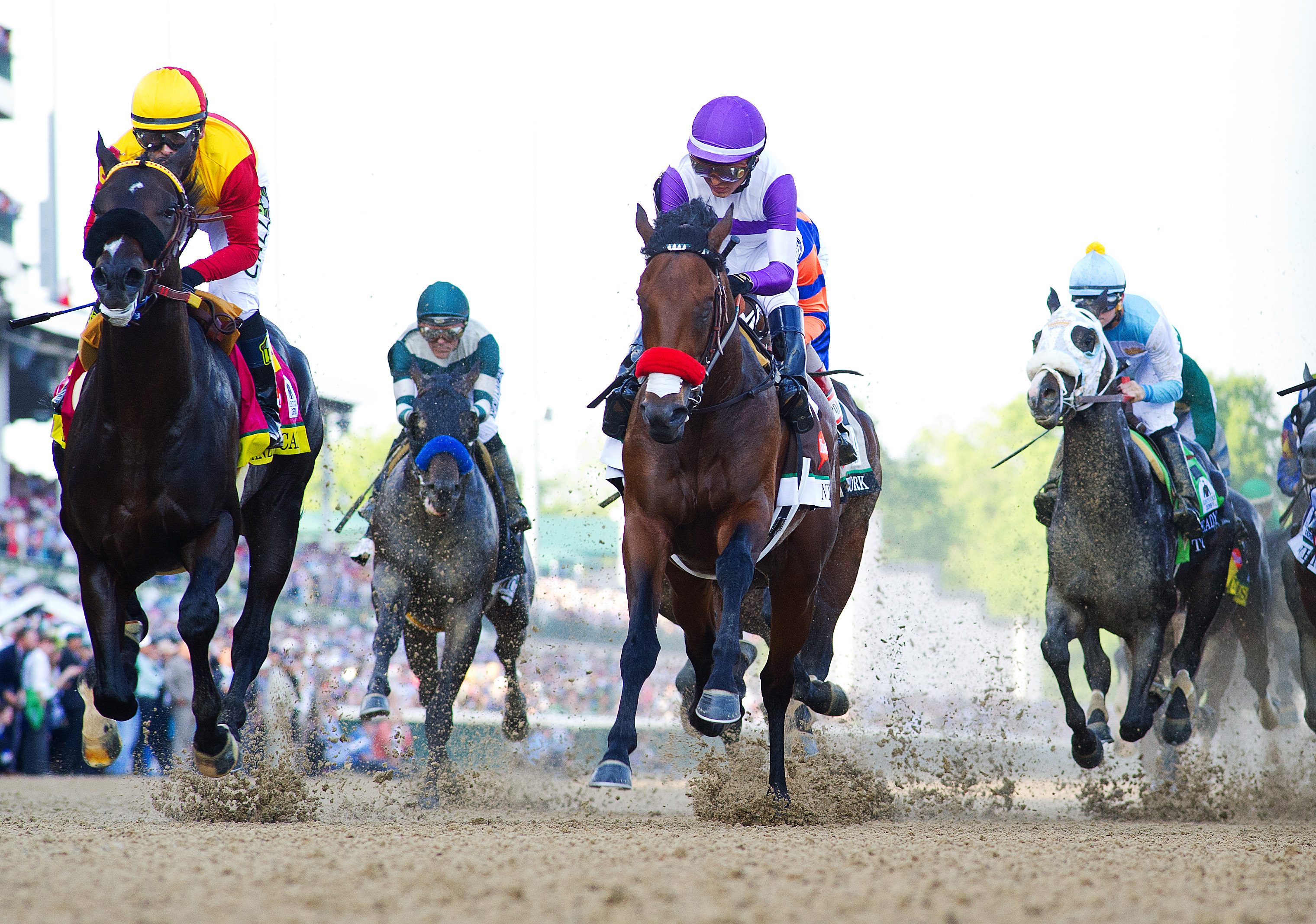 Nyquist remains undefeated in eight races and is the eighth unbeaten winner in the 142-year history of the race. (More Derby photos at the back of this gallery.)