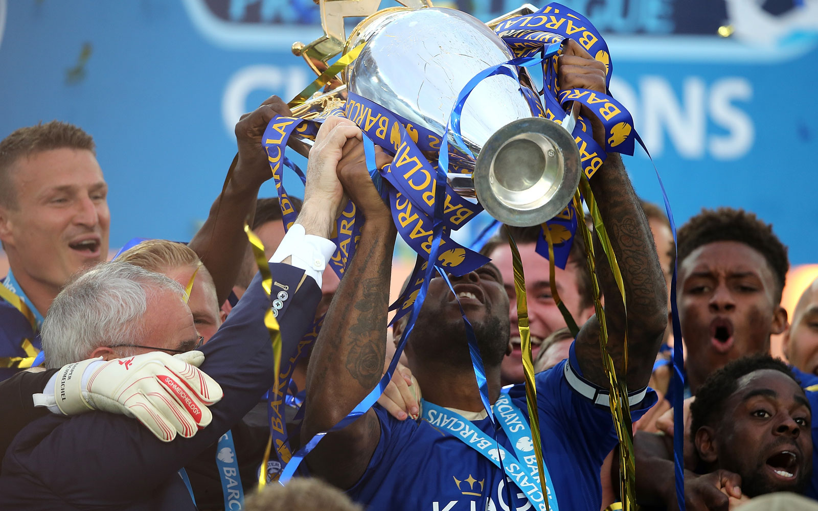 Leicester captain Wes Morgan lifts the Premier League trophy at a capacity King Power Stadium.
