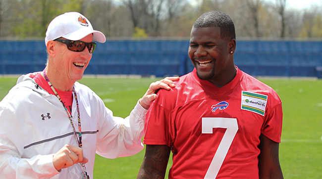 Cardale Jones, whose upbringing makes him an outlier in this study, laughs with former Bills quarterback Jim Kelly at rookie minicamp.