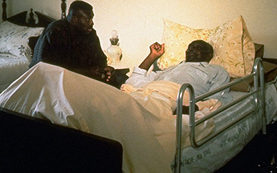 Bruce Smith at the bedside of his father George Smith