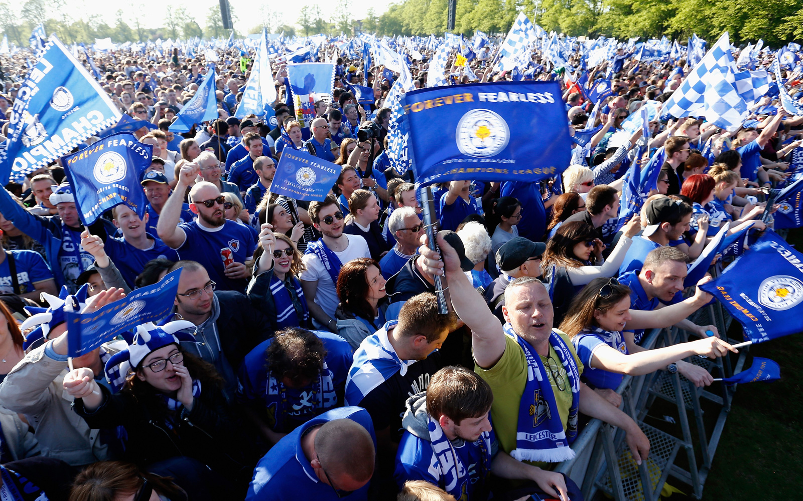 Leicester fans pack the streets to catch a glimpse of their title-winning heroes at the victory parade.