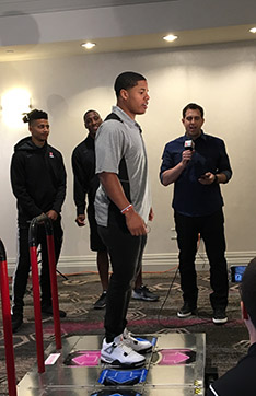 Sterling Shepard tests his footwork with Dance Dance Revolution.