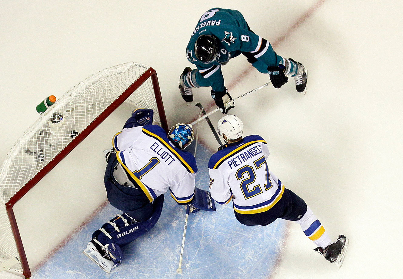 San Jose Sharks' Joe Pavelski (8) scores past St. Louis Blues goalie Brian Elliott (1) and the Blues' Alex Pietrangelo (27) during the first period in Game 6 of the NHL hockey Stanley Cup Western Conference finals Wednesday, May 25, 2016, in San Jose, Calif.