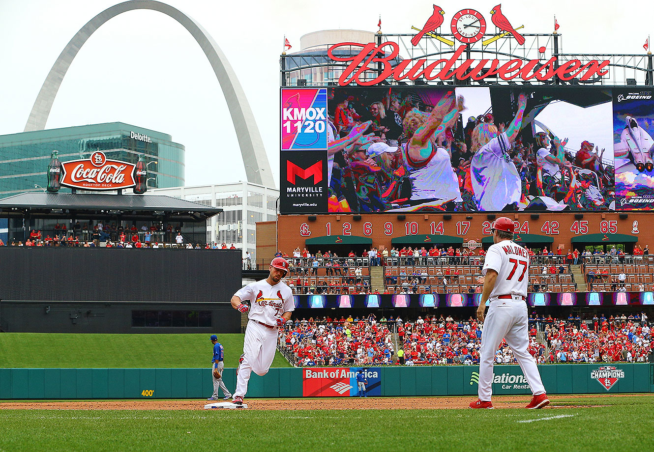 St. Louis Cardinals left fielder Matt Holliday (7) as seen rounding third base after hitting a home run in the bottom of the 6th inning at Bush Stadium.