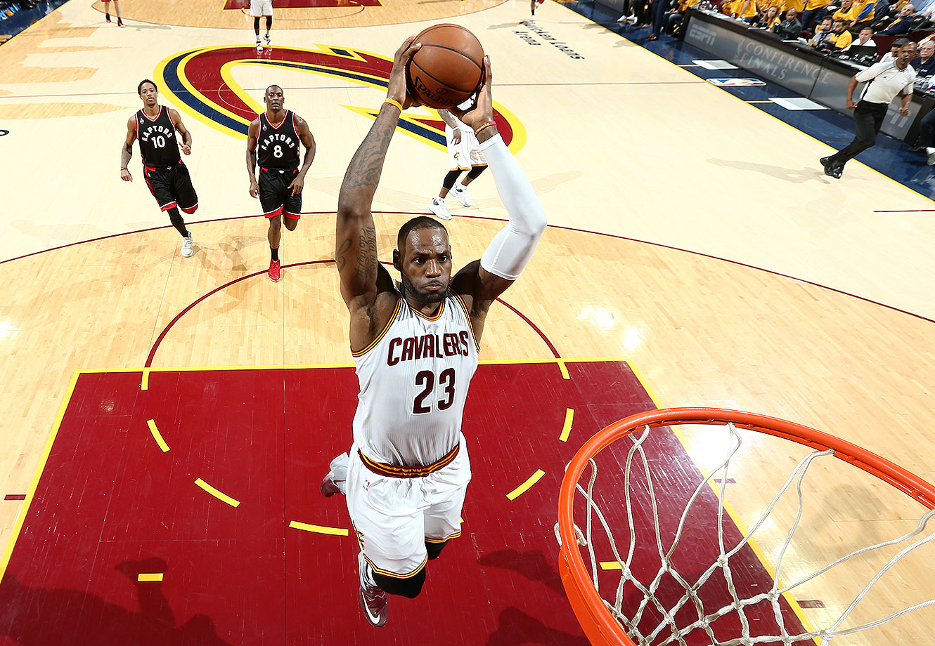 LeBron James #23 of the Cleveland Cavaliers goes up for a dunk against the Toronto Raptors in Game Five of the Eastern Conference Finals during the 2016 NBA Playoffs on May 25, 2016 at Quicken Loans Arena in Cleveland, Ohio.