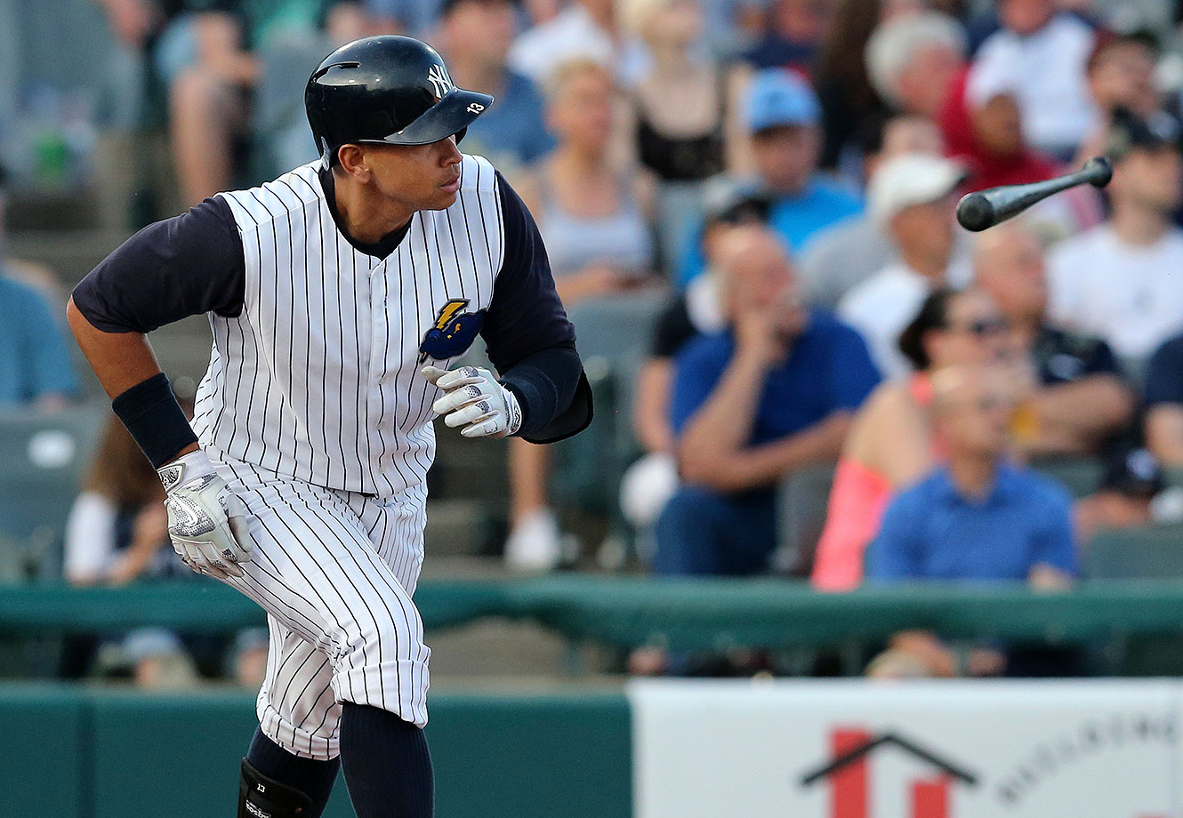 New York Yankees third baseman Alex Rodriguez tosses his bat after hitting a second-inning home run during a minor league rehab game with the Trenton Thunder, against the New Hampshire Fisher Cats on Wednesday, May 25, 2016, in Trenton, N.J.