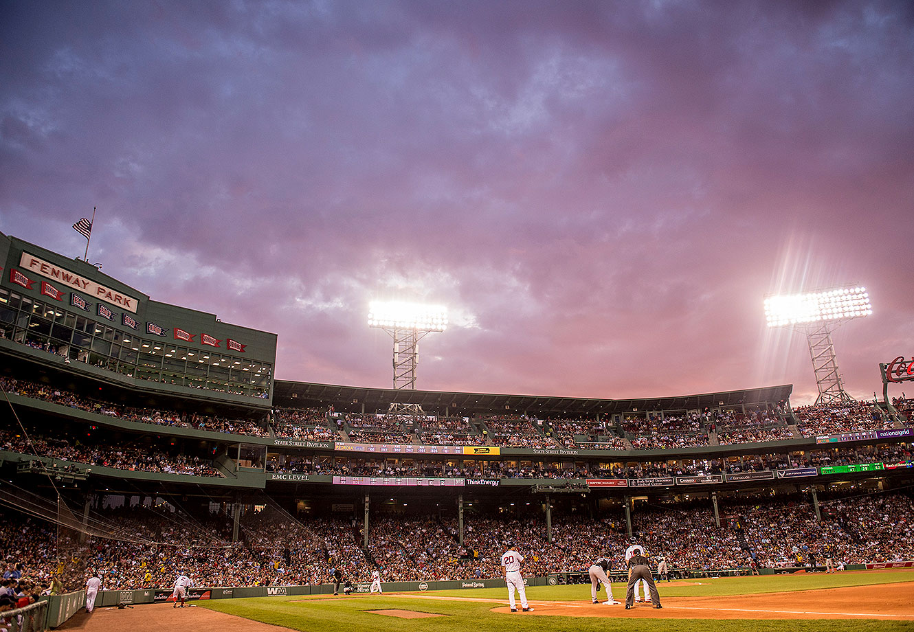 The sun sets during a game between the Boston Red Sox and the Colorado Rockies on May 25, 2016 at Fenway Park in Boston, Massachusetts.