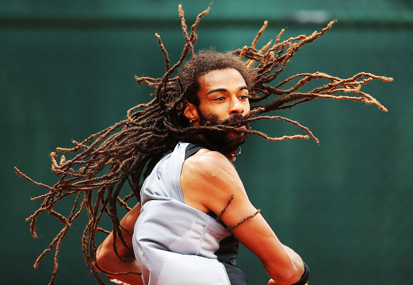 Dustin Brown of Germany plays a shot during the Men's Singles Second Round match against Jack Sock of United States on Day Four of the 2016 French Open at Roland Garros on May 25, 2016 in Paris, France.