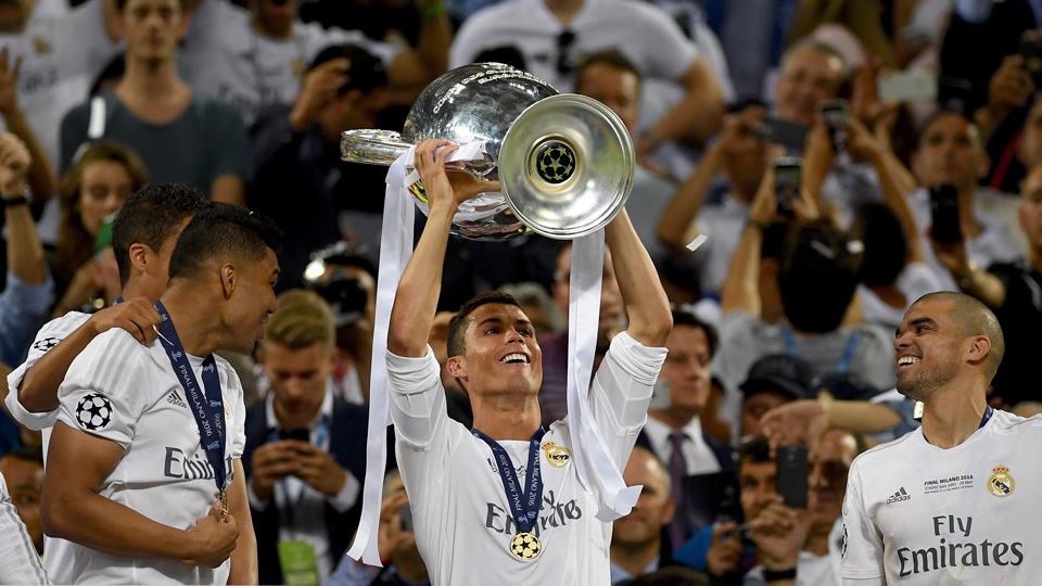 Cristiano Ronaldo lifts the Champions League trophy for Real Madrid
