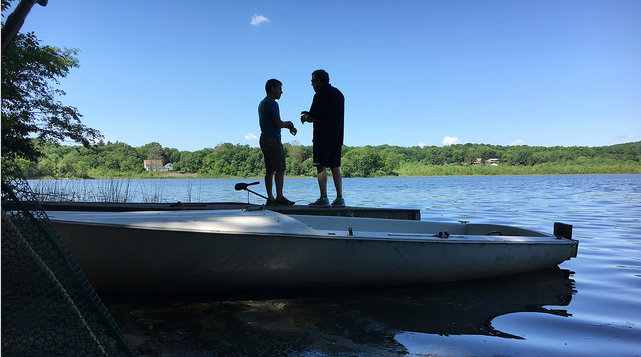 Andrew Brandt (left) and Peter King contemplate story ideas—or perhaps taking a swim—at The MMQB retreat off Lake Kitchawan in New York.