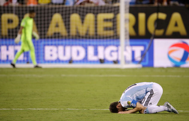Lionel Messi collapses to the ground after missing a penalty at Copa America
