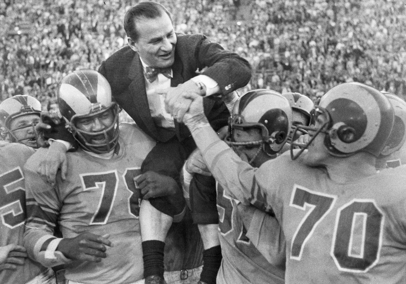 Gillman, in 1955, is carried off the field after a Rams' win over the Packers.
