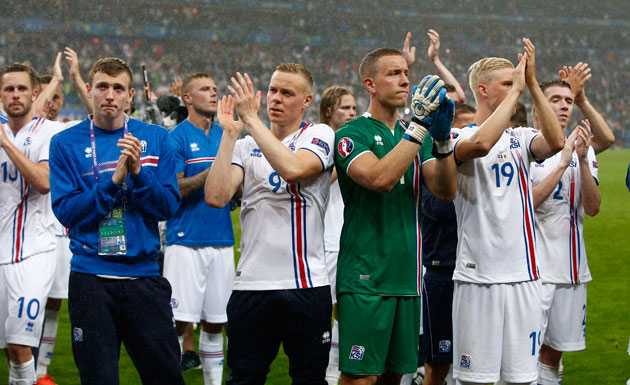 Iceland player salute their fans after bowing out of Euro 2016