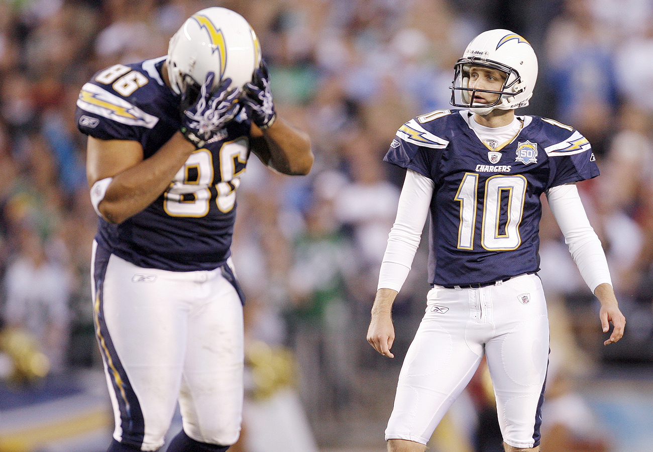 Kaeding and teammate Brandon Manumaleuna moments after the kicker's third field goal attempt sailed wide right during San Diego's 2009 playoff loss to the Jets.