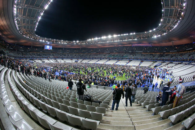 Fans scatter on the field amid the terrorist attacks in Paris in November