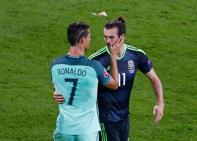 Cristiano Ronaldo and Gareth Bale share an embrace after Portugal's win over Wales in the Euro 2016 semifinal