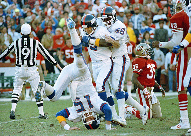 'We made the kick.' Bahr (middle) considers the offense (like Hostetler, quarterback and holder, left), defense (like Lawrence Taylor, right) and special teams unit responsible for every made field goal, like the one that upset the 49ers and sent the Giants to Super Bowl XXV.