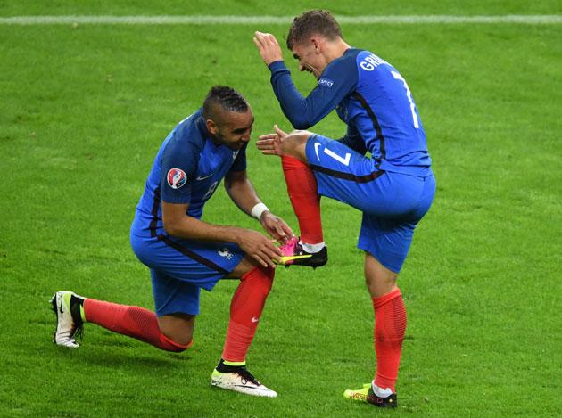 Antoine Griezmann celebrates a Euro 2016 goal with fellow France hero Dimitri Payet