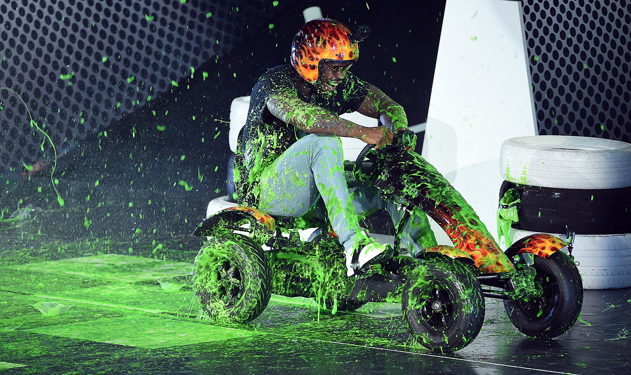 Von Miller was splashed with green twice this week: with paint at the Nickelodeon Kids Choice awards on Thursday, and with money by the Broncos on Friday.