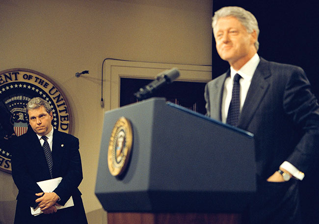 Lockhart, as Clinton speaks at a press conference in 1999.