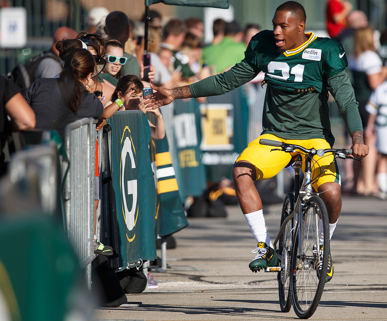 Players riding bikes is an annual tradition at Packers camp in Green Bay.
