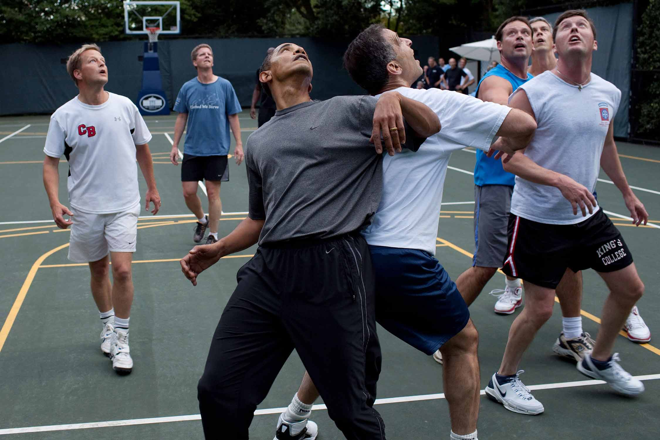 President Barack Obama plays basketball with cabinet secretaries and Congressmen on a White House court in 2009.