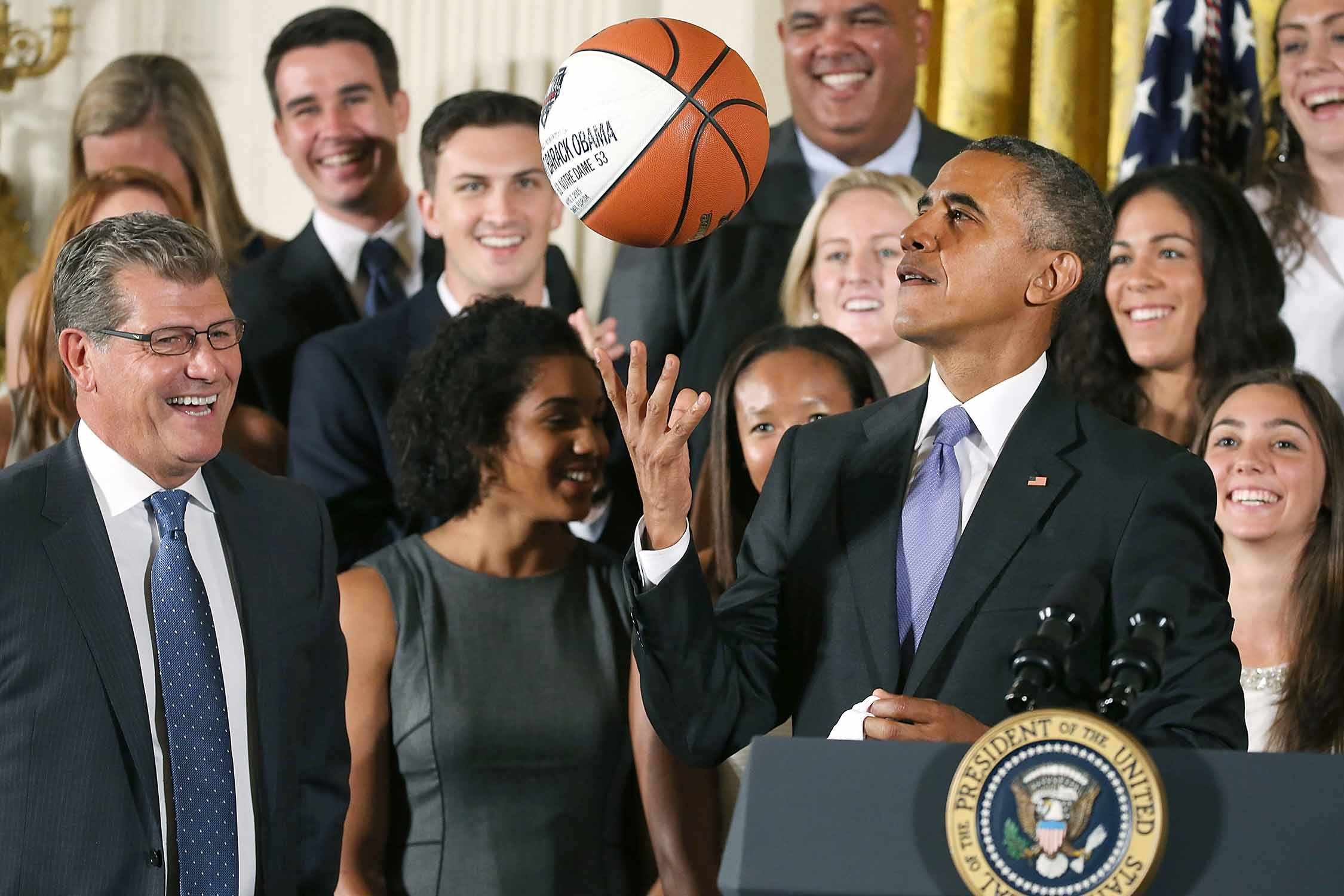 President Barack Obama shows off some of his ball skills to Geno Auriemma and the UConn's women's basketball team in 2015.