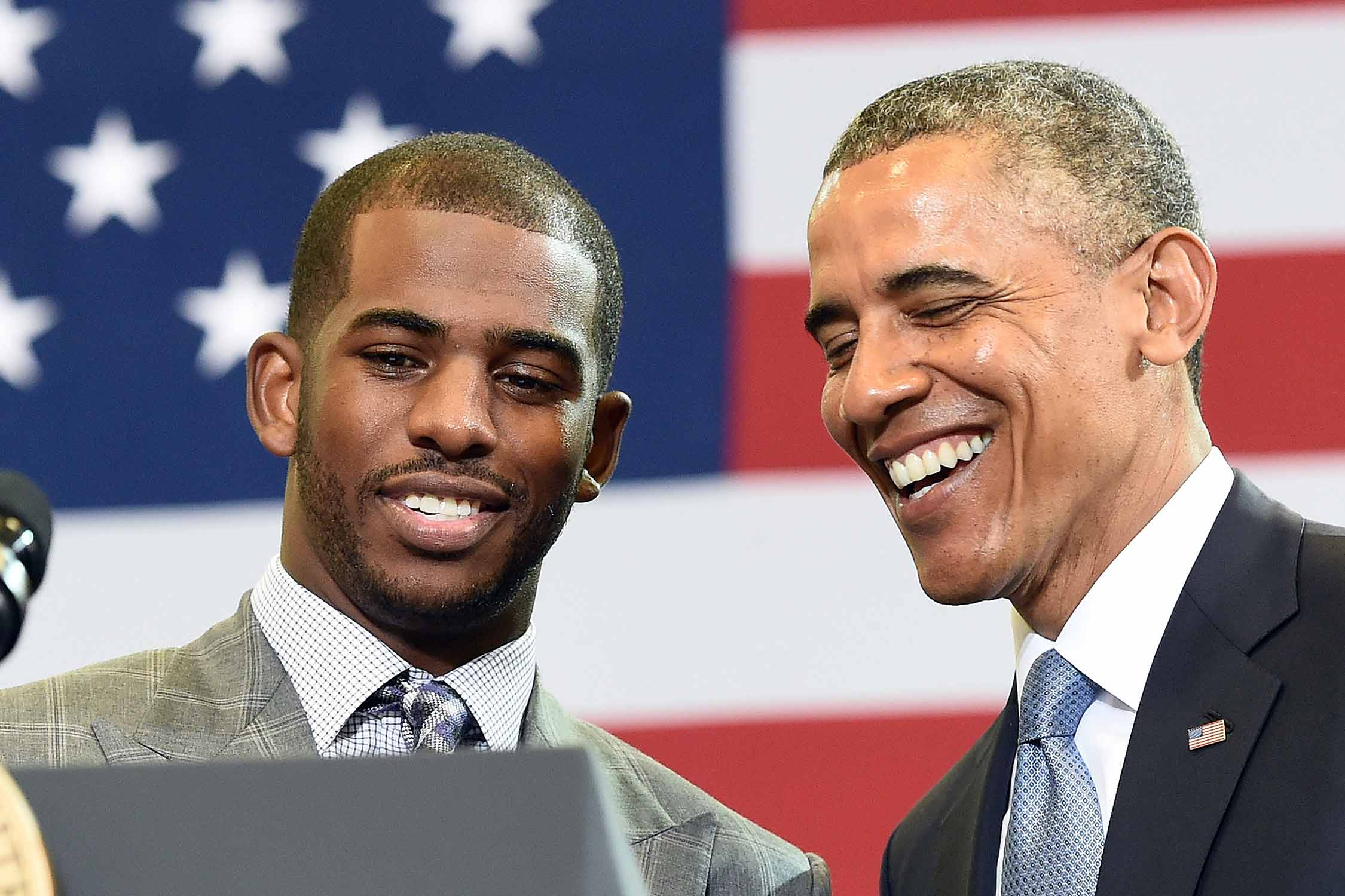 Chris Paul and President Barack Obama chat during a town hall meeting in 2014.