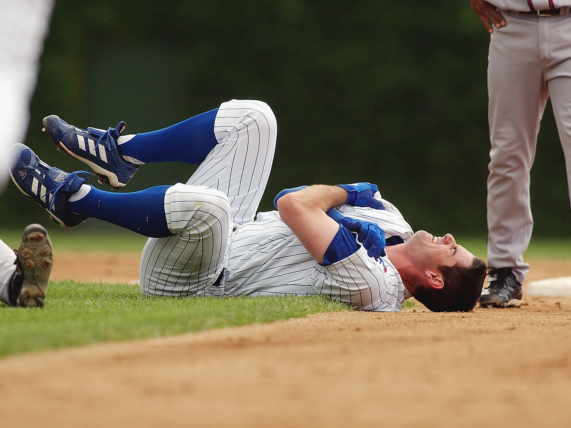 Mark Prior holds his shoulder after a violent 2003 collision with Marcus Giles.