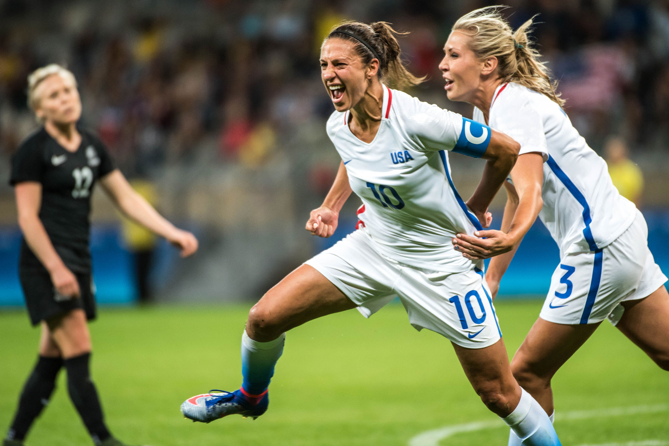 Carli Lloyd celebrates her goal in the USA's 2-0 win over New Zealand in their opening match of group play at the Olympics. Alex Morgan scored the USA's second goal.