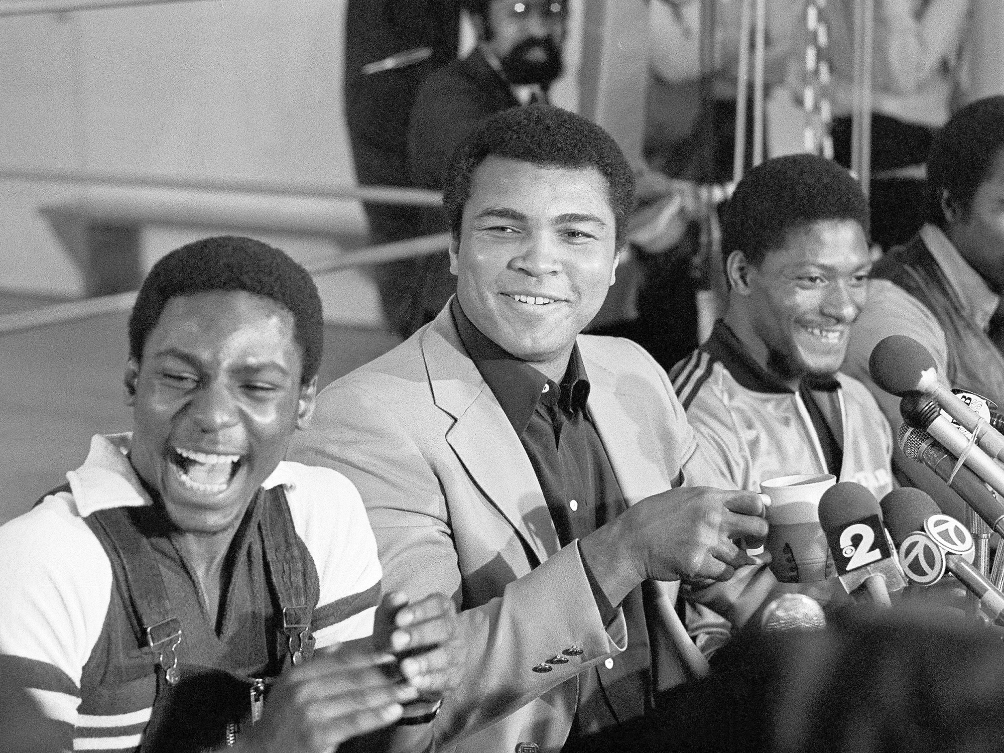 Muhammad Ali bought a one-story brick home for Houston McTear (right) and his family in 1976.