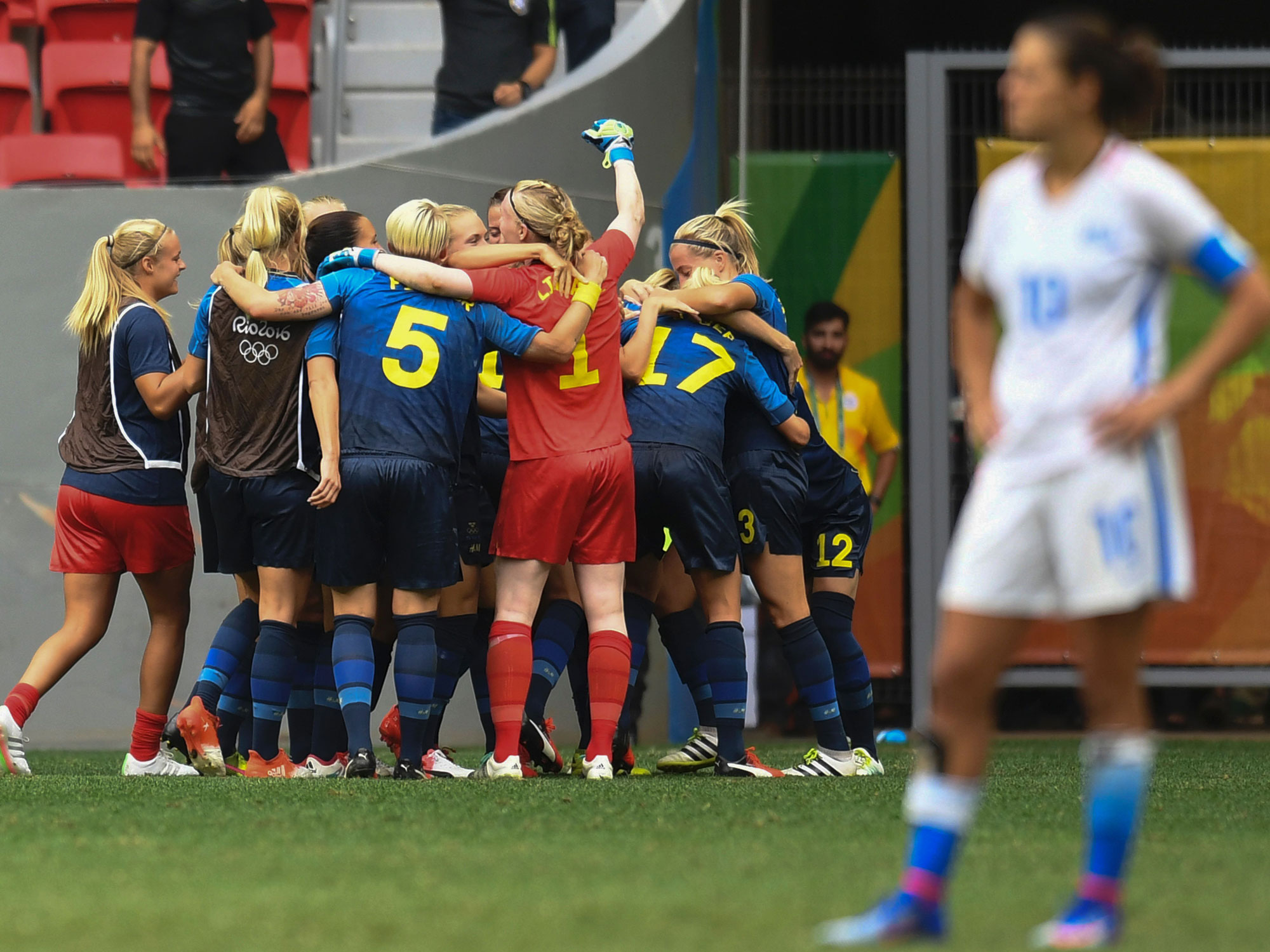 Carli Lloyd can't watch as Sweden celebrates during its win over the USA at the Olympics