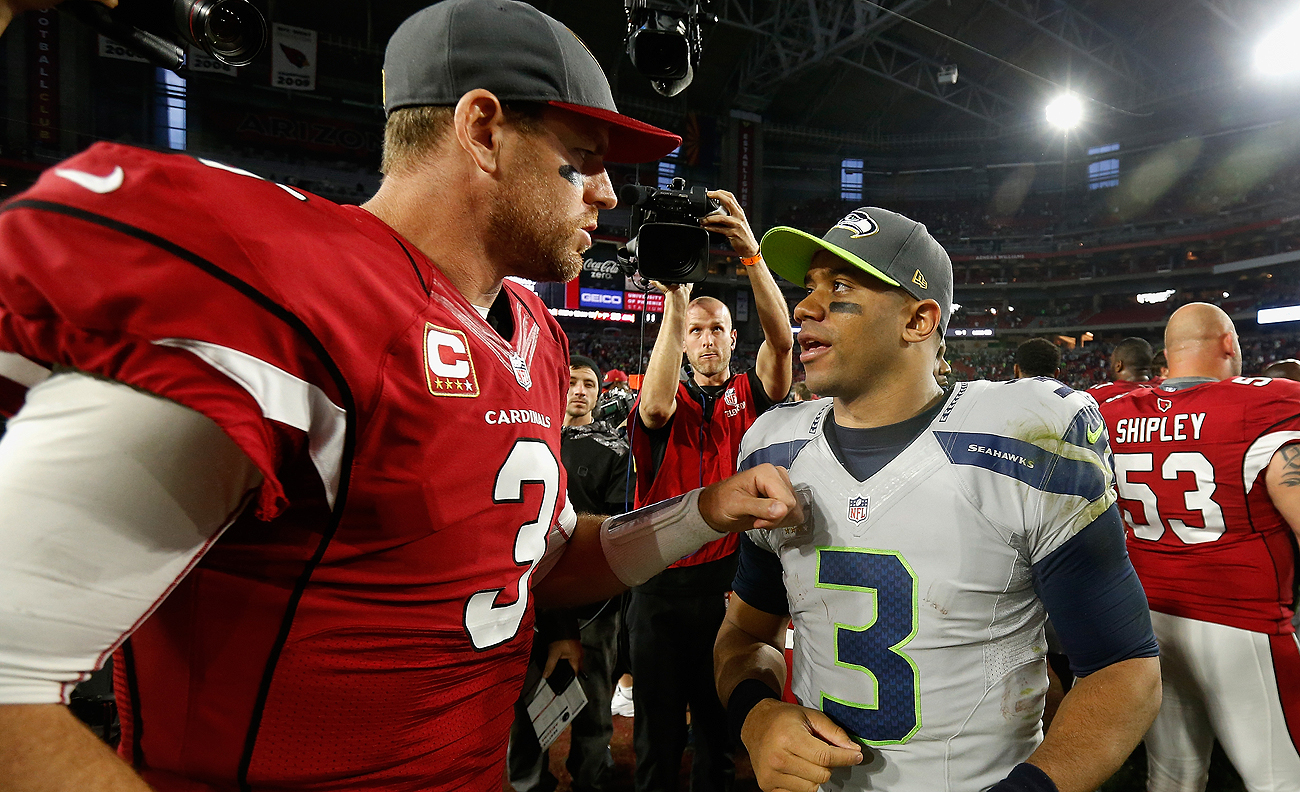 Carson Palmer and Russell Wilson have had success as quarterbacks in the NFC West.