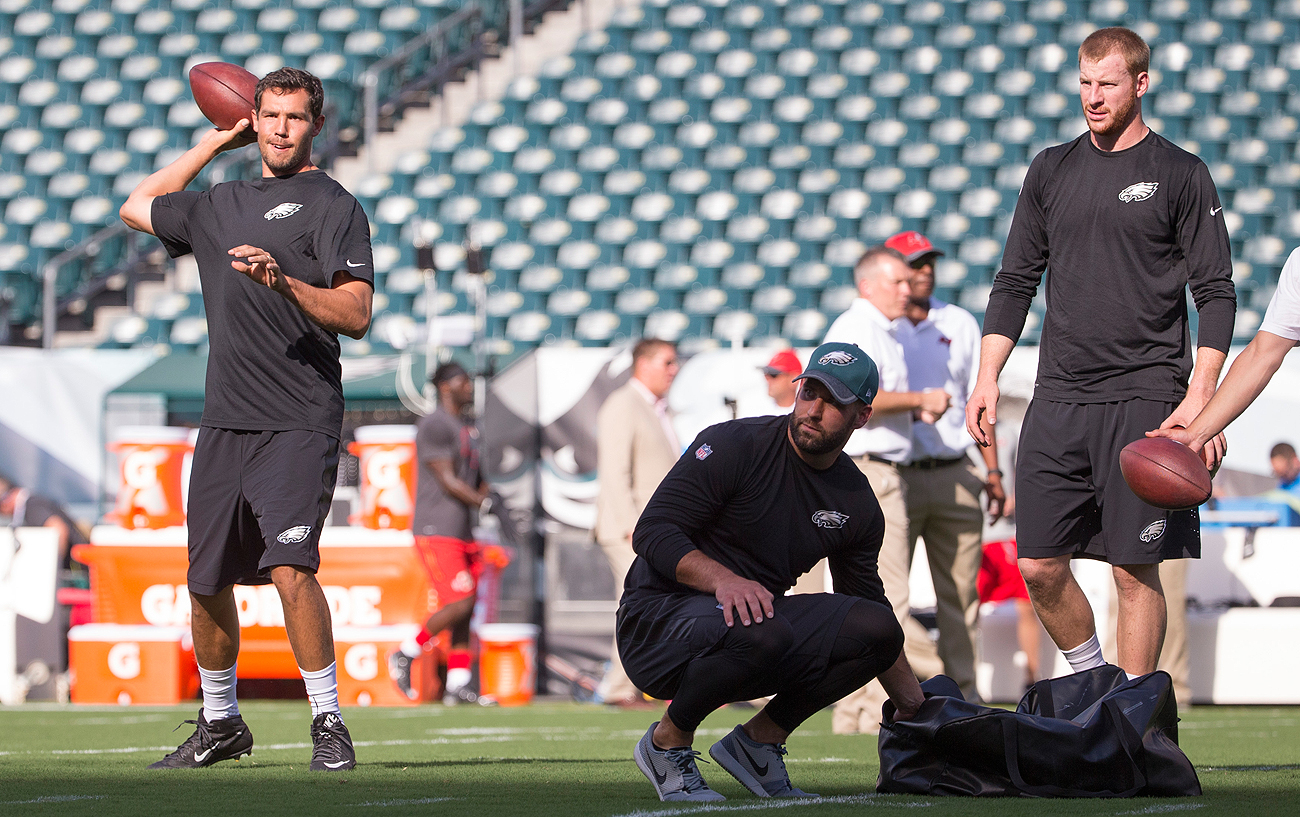 From left: Sam Bradford, Chase Daniel and Carson Wentz are making the best out of a crowded—and competitive—Eagles quarterback room.