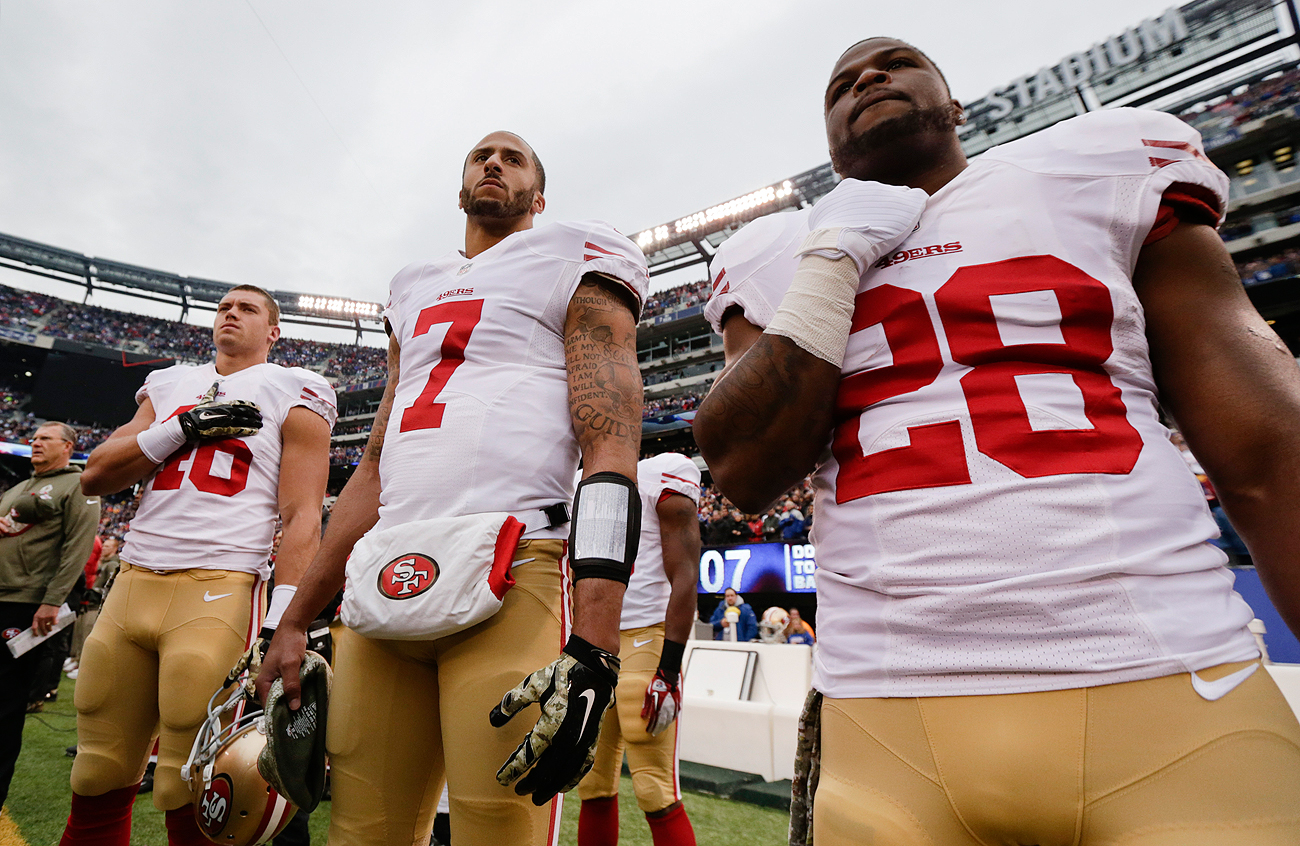 colin kaepernick anthem protest grabs national interest the mmqb as this 2014 file photo shows kaepernick stood for anthems in previous seasons before deciding to make a statement in 2016