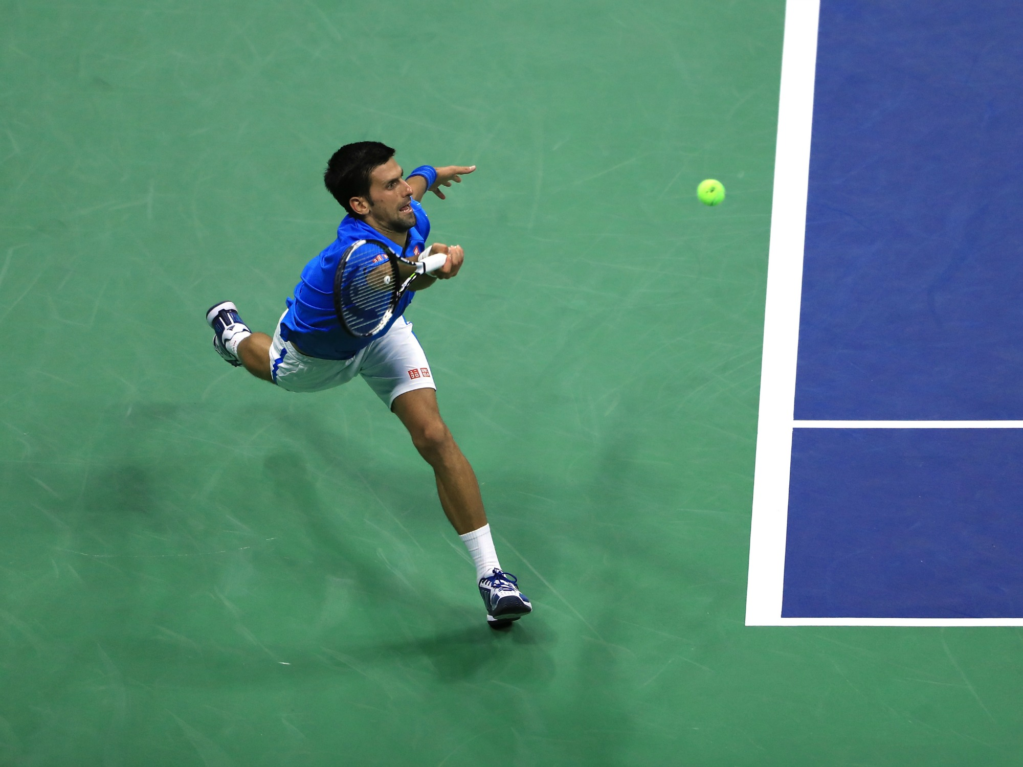 Novak Djokovic stretches for a ball at U.S. Open day one