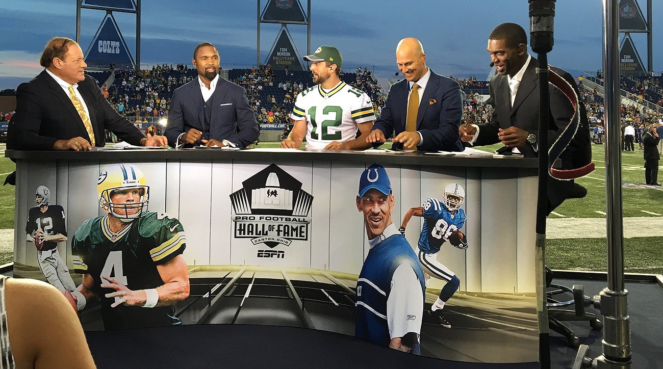 "After seeing his former teammate on the ESPN set, Packers quarterback Aaron Rodgers teased Woodson, ""Now, you're really on another team."""