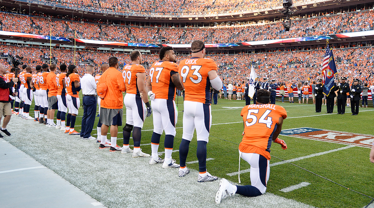 Brandon Marshall, who played college football with Colin Kaepernick, took a knee during the national anthem before Thursday night's game in Denver.