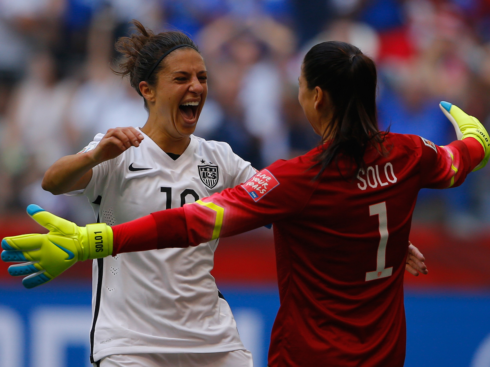 Carli Lloyd and Hope Solo rejoice after winning the 2015 Women's World Cup