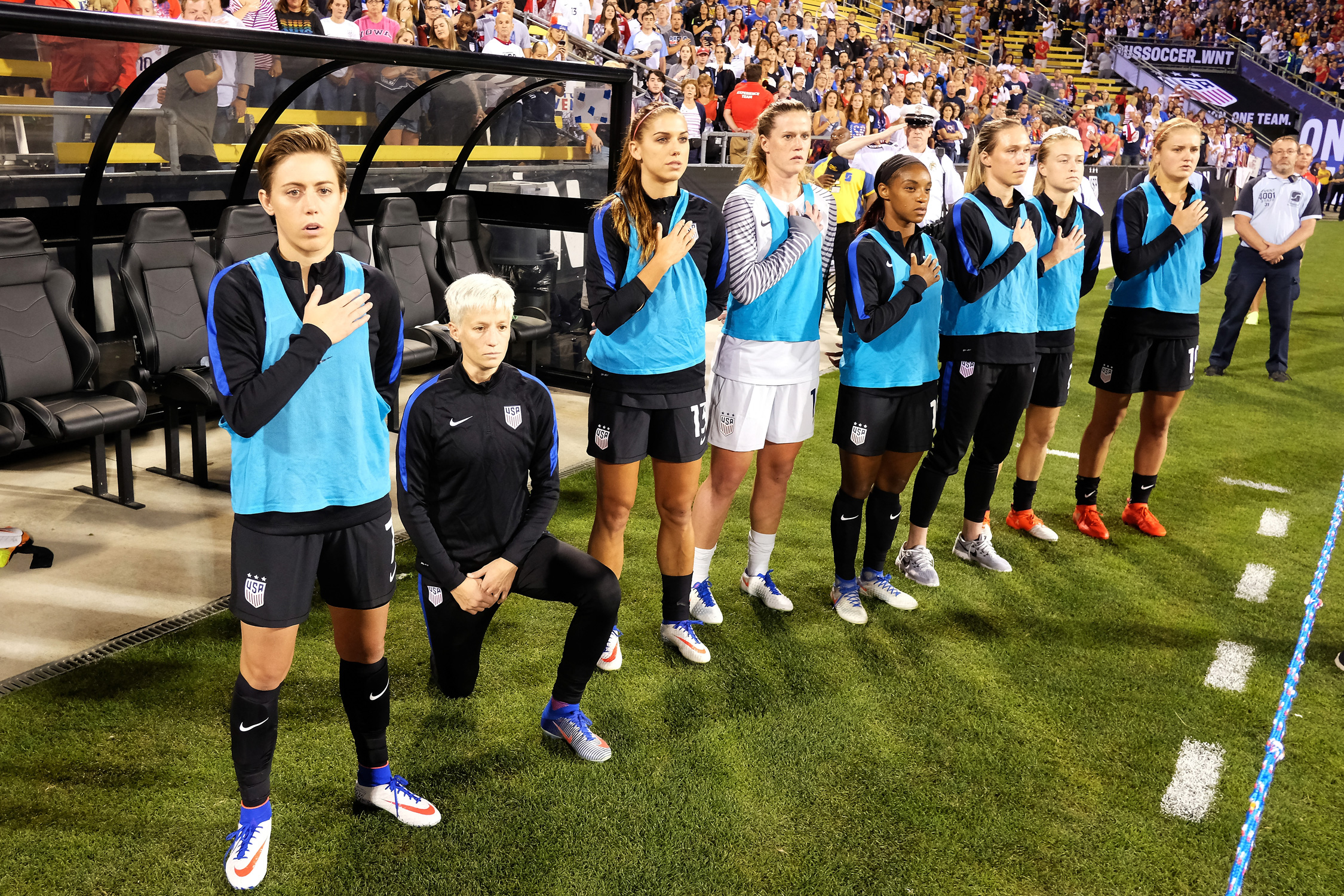 Megan Rapinoe kneels for the national anthem ahead of the U.S. women's national team's match vs. Thailand, continuing her public protest in line with that of San Francisco 49ers quarterback Colin Kaepernick.