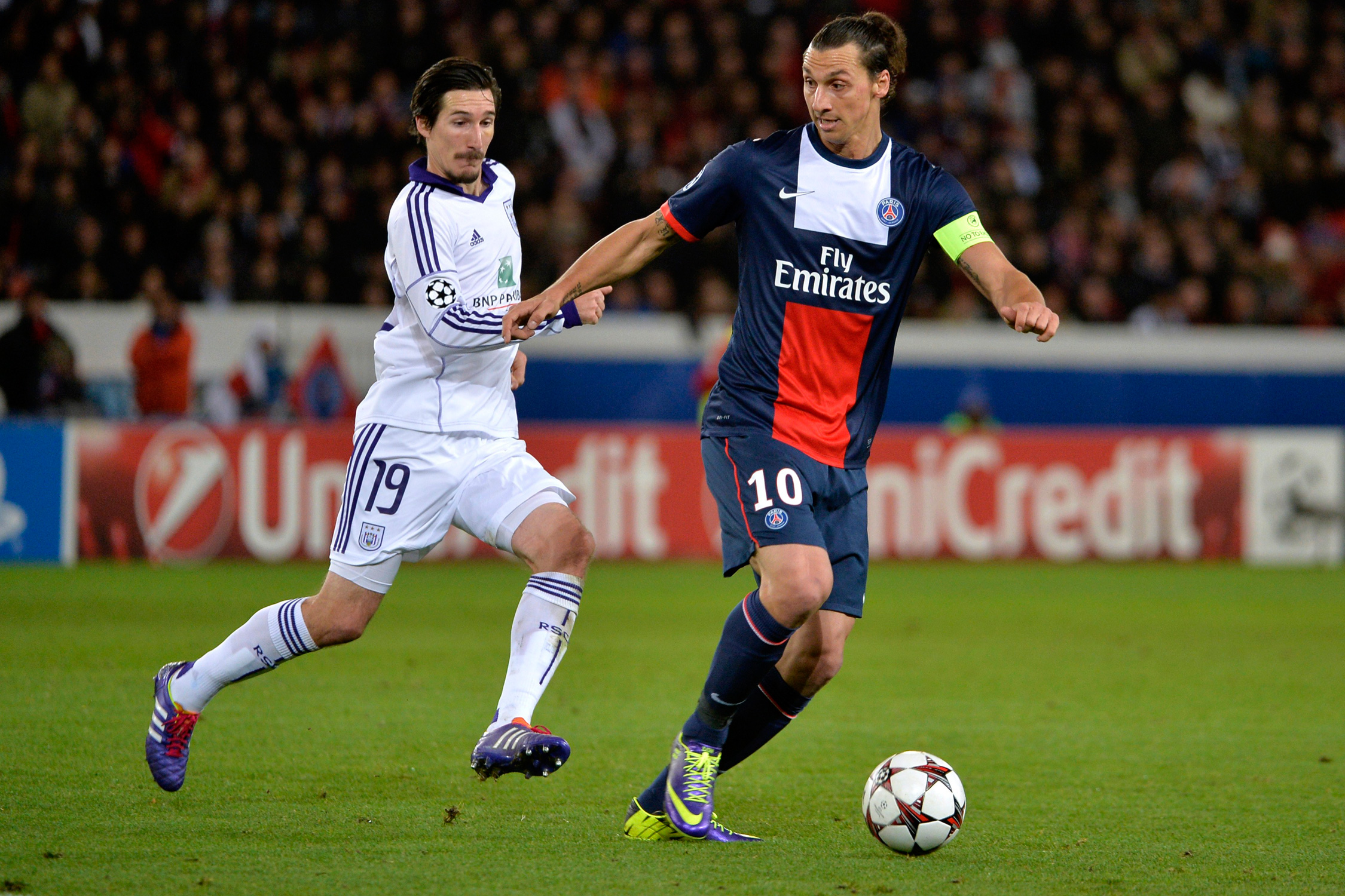 Anderlecht's Sacha Kljestan chases down PSG's Zlatan Ibrahimovic in a Champions League group match in 2013.