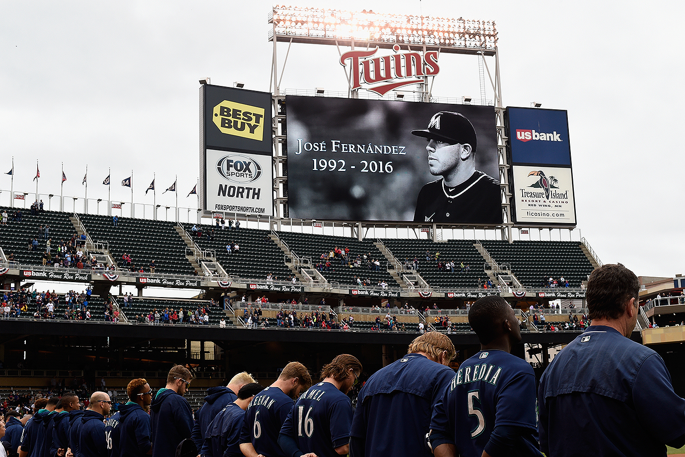 The Seattle Mariners observe a moment of silence in remembrance of Jose Fernandez before their game against the Minnesota Twins on Sunday, Sept. 25, 2016 at Target Field in Minneapolis, Minn.