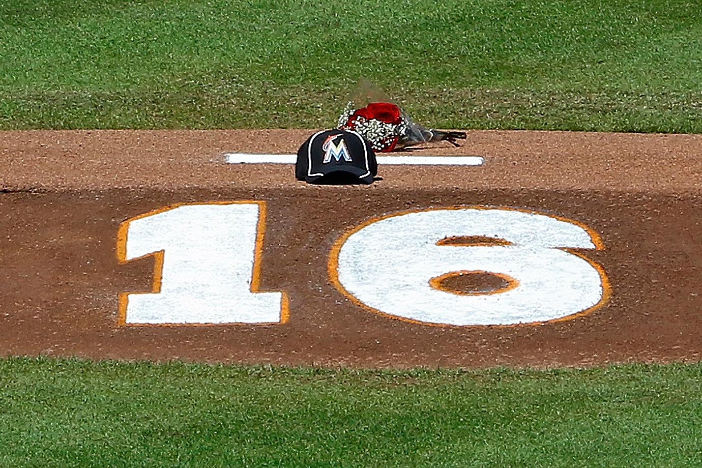 Flowers, a hat and the number of Jose Fernandez are shown on the pitching mound on Sunday, Sept. 25, 2016 at Marlins Park in Miami.