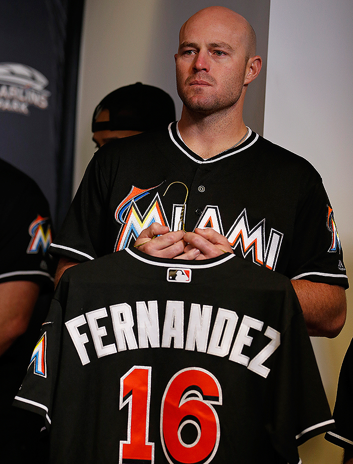 Miami Marlins relief pitcher Mike Dunn holds a Jose Fernandez jersey during a press conference on Sunday, Sept. 25, 2016 at Marlins Park in Miami.