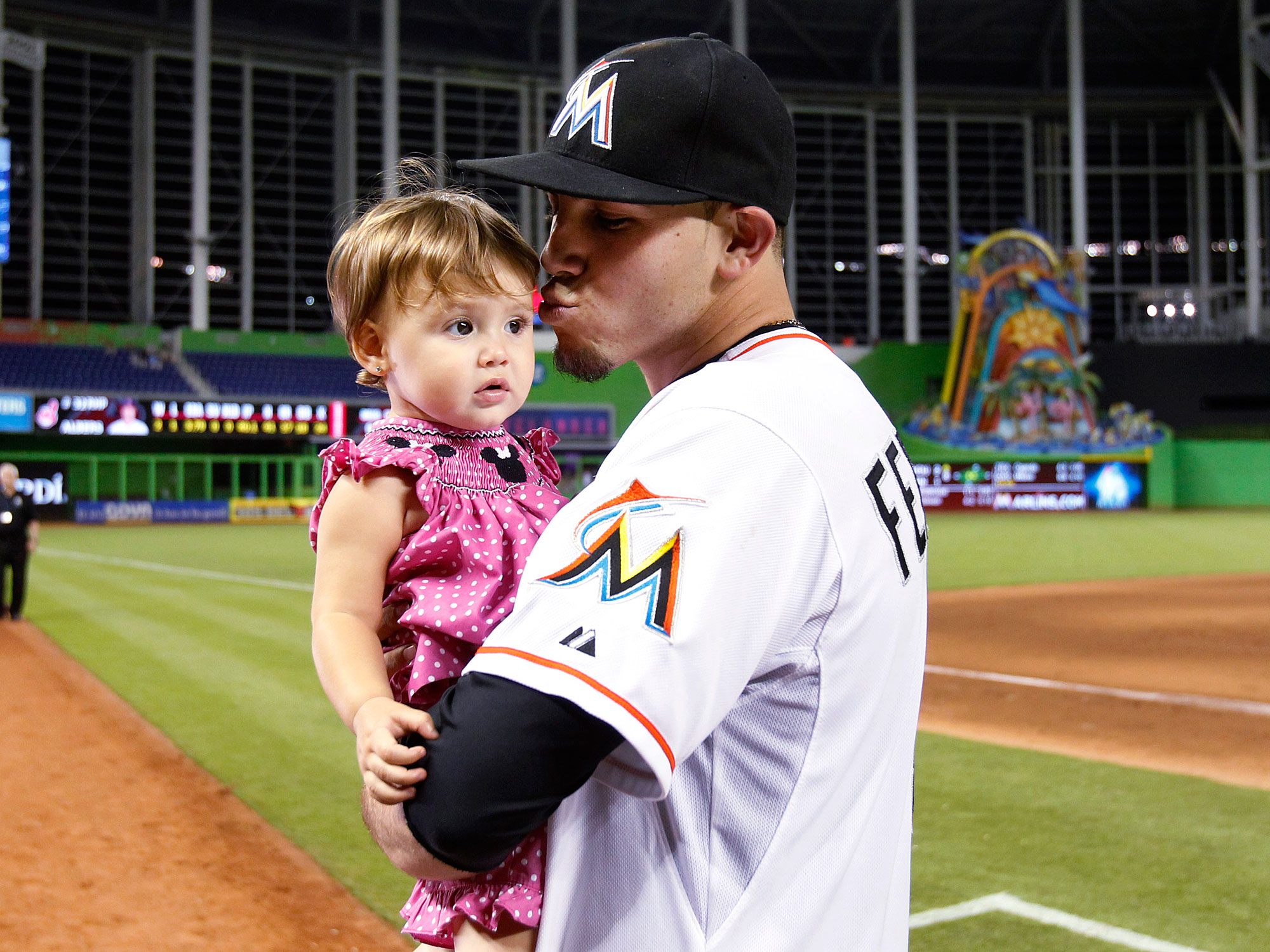 Jose Fernandez with his sister, Saleth Jimenez, after beating the Indians on Aug. 2, 2013.